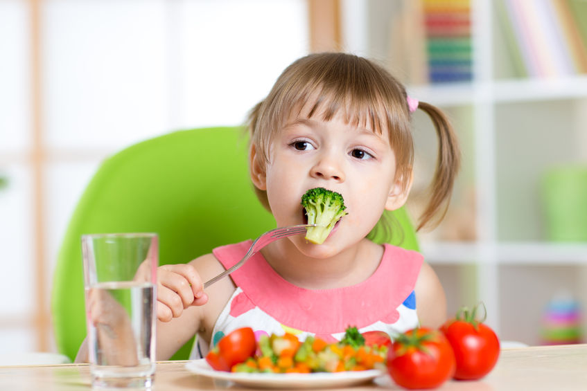 44248780 - child little girl eats vegetable salad using fork