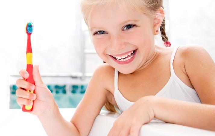 14767428 - little girl brushing teeth in bath