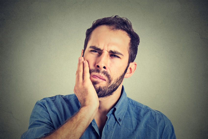 46737863 - young man with a toothache tooth pain