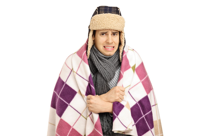 88917893 - young man covered with a blanket feeling cold isolated on white background