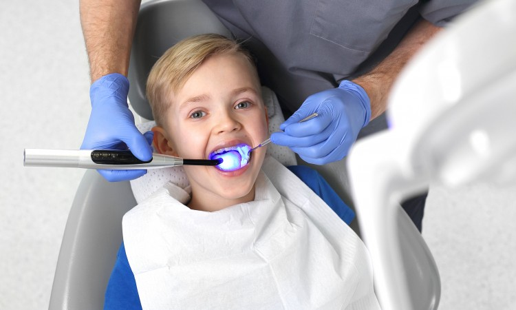 Light-curing seal, a child in a dental office